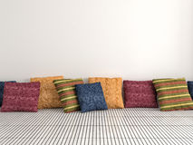Colorful cushions on background white wall. 3d illustration Stock Photos