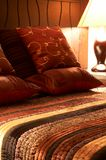 Colorful cushions on the bed. Colorful cushions on a bed in a guest lodge Royalty Free Stock Photos