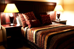 Colorful cushions on the bed. Colorful cushions on a bed in a guest lodge stock image