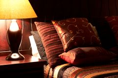 Colorful cushions on the bed. Colorful cushions on a bed in a guest lodge Royalty Free Stock Images