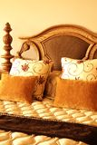 Colorful cushions on the bed Royalty Free Stock Photos