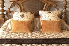 Colorful cushions on the bed Royalty Free Stock Images