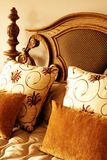 Colorful cushions on the bed. Colorful cushion on a double bed in a guest lodge royalty free stock photos