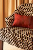 Colorful cushions on the chair. Colorful cushions on a chair in a guest lodge Stock Photography