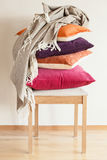 Colorful cushions on chair cozy home mood royalty free stock image