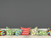 Colorful cushions and a gray wall Royalty Free Stock Photography