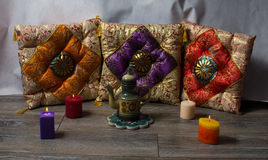 Colorful cushions in Oriental style ceramic teapot and colored b Royalty Free Stock Images
