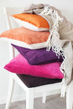 Colorful cushions throw cozy home autumn mood stock images