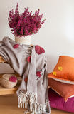 Colorful cushions throw cozy home autumn mood flower leaf.  royalty free stock photo
