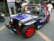 A colorful, custom made jeep parked in the middle of a street during a parade in Antipolo City. ANTIPOLO CITY, PHILIPPINES - MAY 1, 2017: A colorful, custom royalty free stock image