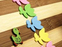 Colorful cut tulips and duck on a chopping board Stock Photo