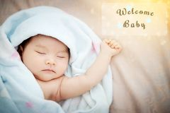 Colorful cute baby shower beautiful card with text welcome. New baby in transparent frame, with the gold elements , star and wonderful bokeh in the morning Stock Photo