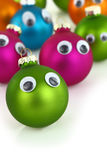 Colorful cute Christmas balls with eyes Royalty Free Stock Photography