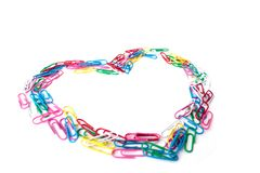 Colorful cute heart from the paperclips on the white royalty free stock photos
