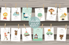 Colorful cute monthly calendar 2017 with lion,tiger,panda,tree a. Nd bear travel vacation.Can be used for web,banner,poster,label and printable Royalty Free Stock Photos