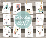Colorful cute monthly calendar 2017 with tent,whale,feather,arro Stock Photography