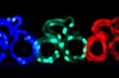 Colorful cyclist shape bokeh lights Royalty Free Stock Photos