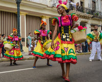Colorful dancers in the street in Havana, Cuba. HAVANA, CUBA JUNE 9, 2016 Dancers in colorful costumes celebrate Havana Day with a parade along Paseo de Marti in Stock Photo