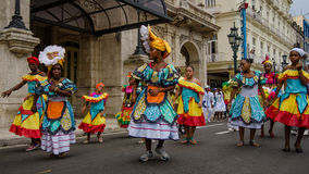 Colorful dancers in the street in Havana, Cuba. HAVANA, CUBA JUNE 9, 2016 Dancers in colorful costumes celebrate Havana Day with a parade along Paseo de Marti in Stock Image