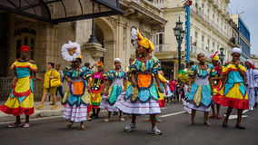 Colorful dancers in the street in Havana, Cuba. HAVANA, CUBA JUNE 9, 2016 Dancers in colorful costumes celebrate Havana Day with a parade along Paseo de Marti in Royalty Free Stock Image