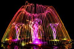 Colorful dancing fountain Stock Image