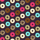 Colorful dark pattern with tasty topping donuts Stock Photo