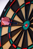 Colorful dart and target with green, yellow and red colors at th. E dartboard center Royalty Free Stock Images