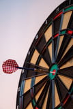 Colorful dart and target with green, yellow and red colors at th. E dartboard center Royalty Free Stock Photo
