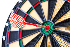 Colorful darts board close up with arrows in the bullseye Royalty Free Stock Photo