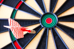Colorful darts board close up with arrows in the bullseye Stock Photos