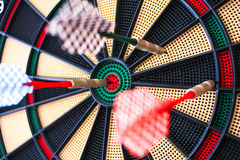 Colorful darts board close up with arrows in the bullseye Stock Photography