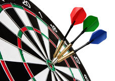 Colorful darts hitting a target Royalty Free Stock Photo