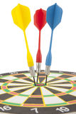 Colorful darts hitting a target. Royalty Free Stock Photos