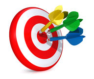 Colorful darts hitting a target Stock Photo