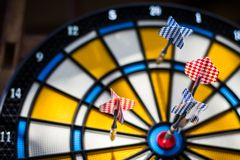 Colorful darts hitting a target. Shallow dof Stock Photography