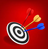 Colorful darts hitting a target. Success concept. Stock Photos
