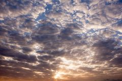 Colorful dawn/dusk sky with clouds . Colorful dawn/dusk sky with clouds background Royalty Free Stock Photo