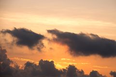 Colorful dawn/dusk sky with dark clouds. Colorful dawn/dusk sky with dark clouds background Royalty Free Stock Photo