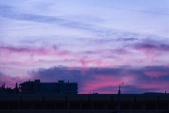 Colorful dawn/dusk sky over some buildings. Colorful dawn/dusk sky over some buildings silhouettes Royalty Free Stock Photo