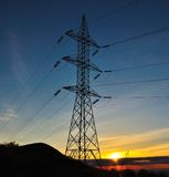 Colorful dawn with imposing electrical tower Royalty Free Stock Images