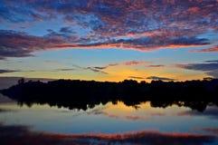 Colorful Dawn. Reflection over a calm river Stock Photos
