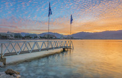 Colorful dawn with water reflection on the northern beach of Eilat at dawn Royalty Free Stock Photos