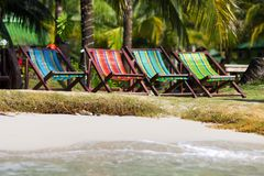 Colorful deckchairs on the beach Stock Photo