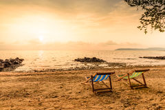 Colorful decks for relaxation on beach Stock Photos