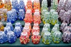 Colorful decor wax candle sell outdoor market fair Stock Photos