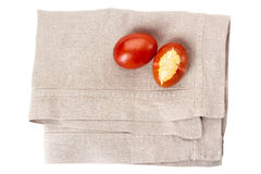 Colorful decorated easter eggs on linen napkin over white Stock Photos