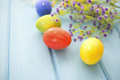 Colorful decorated easter eggs on white wood background. Happy Easter Stock Photography