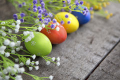 Colorful decorated easter eggs on white wood background. Happy Easter Stock Photos