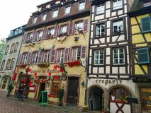 Colorful and decorated houses in the streets of Colmar stock images