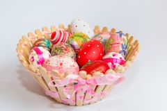 Easter eggs in wooden basket stock photo